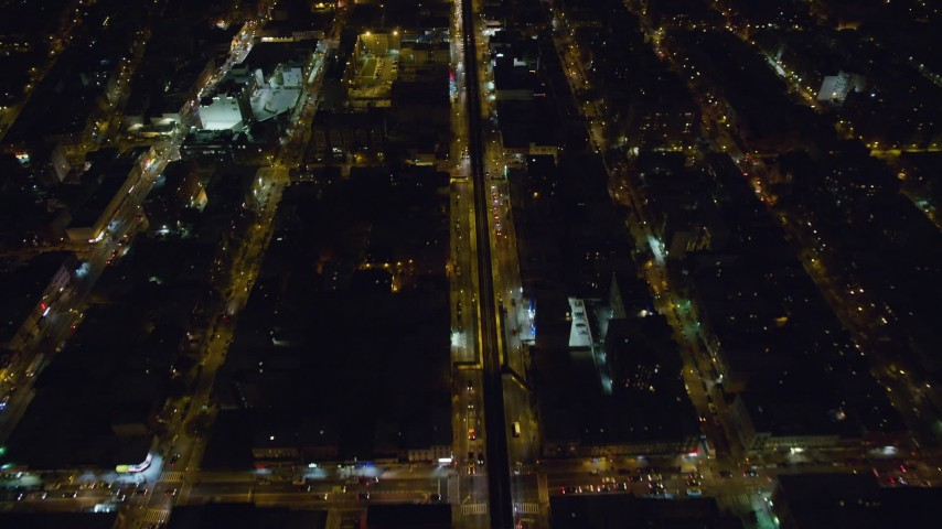 6K stock footage aerial video of bird's eye of elevated rail on Atlantic Avenue at Night in Brooklyn, New York City Aerial Stock Footage | AX123_125