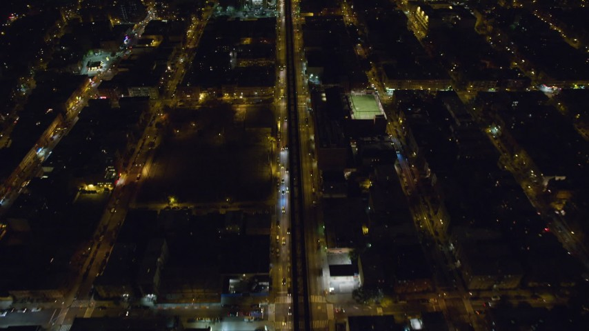 6K stock footage aerial video of a bird's eye view of elevated rail on Atlantic Avenue at Night in Brooklyn, New York City Aerial Stock Footage | AX123_126