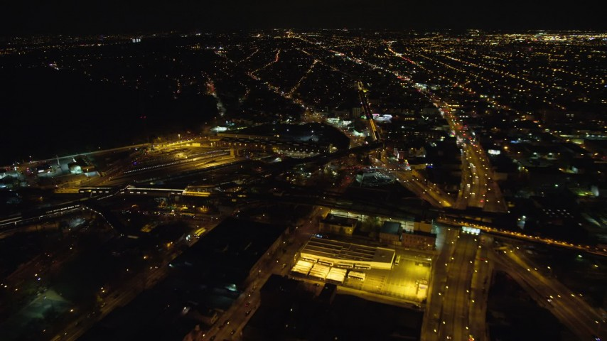 5.5K stock footage aerial video approach East New York Yard at Night in Brooklyn in New York City Aerial Stock Footage   AX123_130E