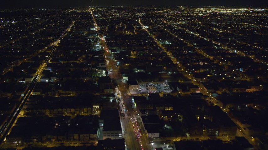 6K stock footage aerial video fly over Atlantic Avenue through Brooklyn at Night in New York City Aerial Stock Footage | AX123_133
