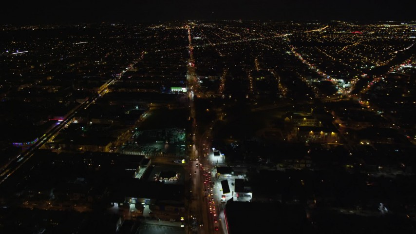 5.5K stock footage aerial video fly over Atlantic Avenue through Brooklyn at Night in New York City Aerial Stock Footage   AX123_133E