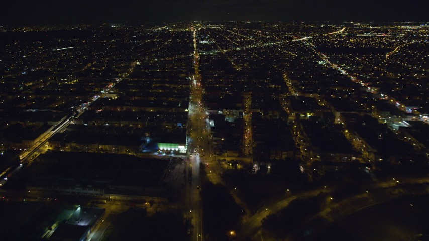 6K stock footage aerial video follow Atlantic Avenue through Brooklyn at Nighttime in New York City Aerial Stock Footage | AX123_135