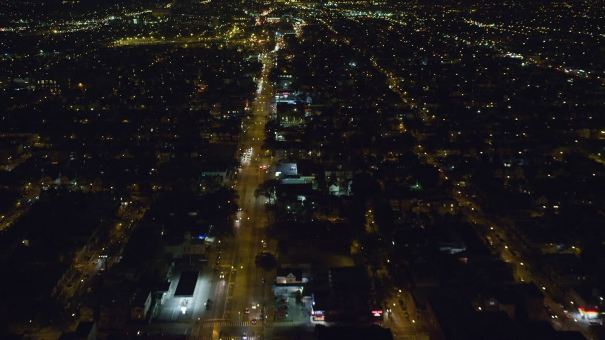 6K stock footage aerial video of following Atlantic Avenue through Queens at Nighttime in New York City Aerial Stock Footage | AX123_138