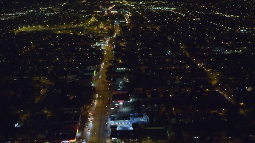 6K stock footage aerial video of following Atlantic Avenue with light traffic through Queens at Night in New York City Aerial Stock Footage | AX123_139