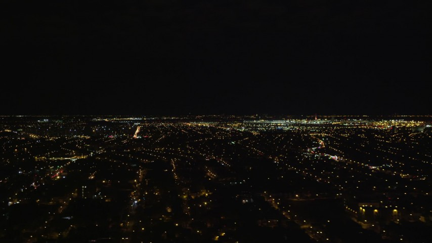 5.5K stock footage aerial video of a wide view of JFK International Airport at Night in New York City Aerial Stock Footage | AX123_143E