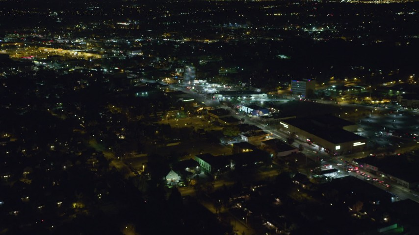 6K stock footage aerial video approach shops and restaurants at Night in West Hempstead, New York Aerial Stock Footage | AX123_159