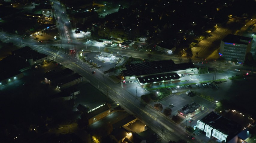 6K stock footage aerial video of shops and restaurants in West Hempstead at Night, New York Aerial Stock Footage | AX123_160