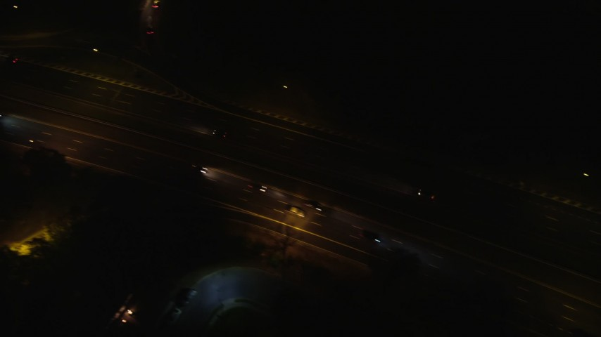 6K stock footage aerial video of a bird's eye view of light traffic on Southern State Parkway at Night in Farmingdale, New York Aerial Stock Footage | AX123_186