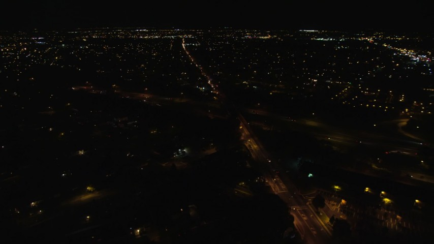 6K stock footage aerial video orbit Southern State Parkway and Carmans Road at Night in Farmingdale, New York Aerial Stock Footage | AX123_187