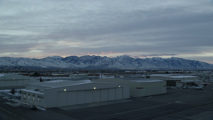 6K stock footage aerial video of the Wasatch Range seen from SLC International Airport in Winter at Sunrise, Utah Aerial Stock Footage | AX124_001