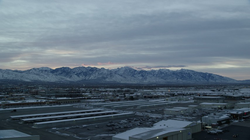 Wasatch Range Viewed from SLC International Airport at Sunrise in Winter Aerial Stock Footage | AX124_002