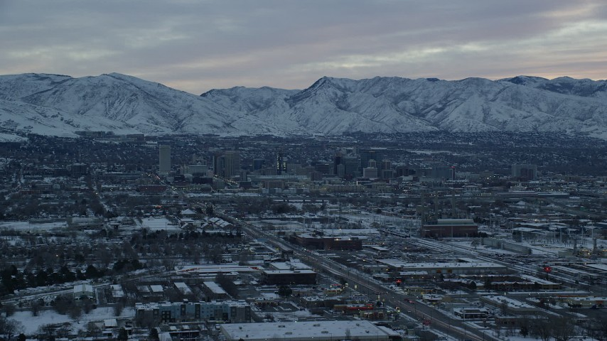 6K stock footage aerial video approach Downtown Salt Lake City, Utah, at Sunrise in Winter Aerial Stock Footage | AX124_003