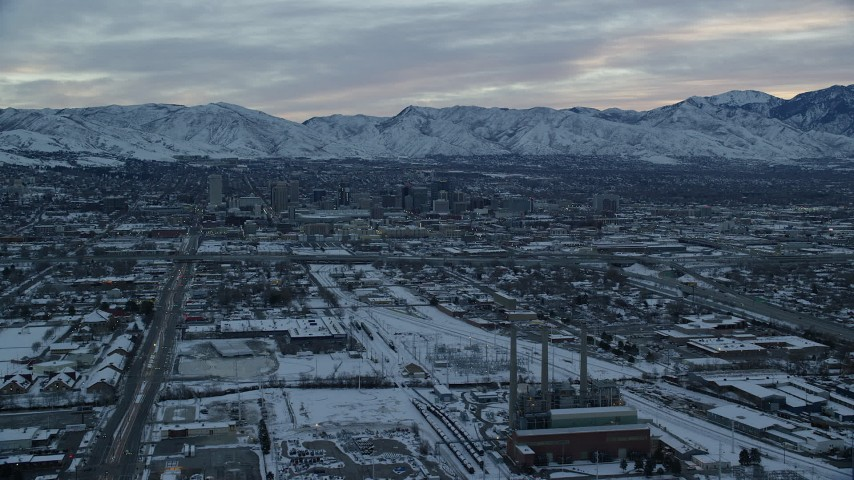 6K aerial video approach Downtown Salt Lake City, Utah, from power plant at Sunrise in Winter Aerial Stock Footage | AX124_005