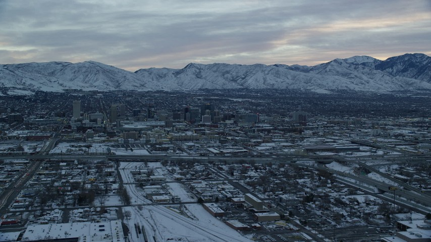 6K stock footage aerial video approach Downtown Salt Lake City at Sunrise in Winter in Utah Aerial Stock Footage | AX124_006