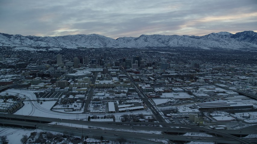 6K stock footage aerial video orbit 200 South and Downtown Salt Lake City at Sunrise in Winter in Utah Aerial Stock Footage | AX124_008