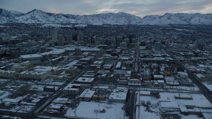 6K stock footage aerial video orbit of Downtown Salt Lake City and 200 South at Sunrise in Winter in Utah Aerial Stock Footage | AX124_009