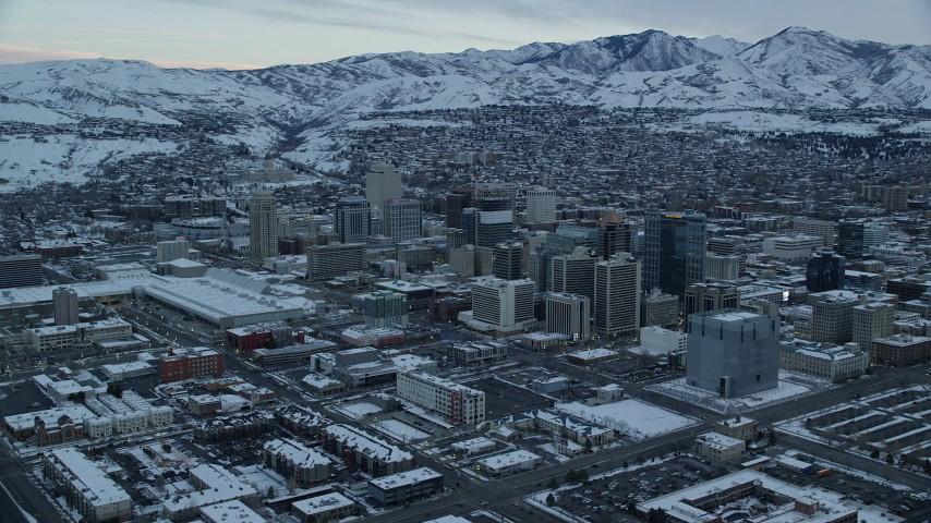 6K stock footage aerial video orbit buildings in Downtown Salt Lake City, Utah at Sunrise in Winter Aerial Stock Footage | AX124_011