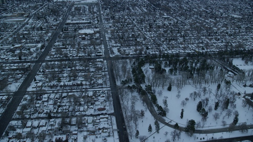 6K stock footage aerial video fly over Liberty Park and suburbs at Sunrise in Winter, Salt Lake City, Utah Aerial Stock Footage | AX124_013