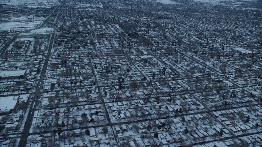6K stock footage aerial video fly over suburban homes in Salt Lake City, Utah at Sunrise in Winter Aerial Stock Footage | AX124_014