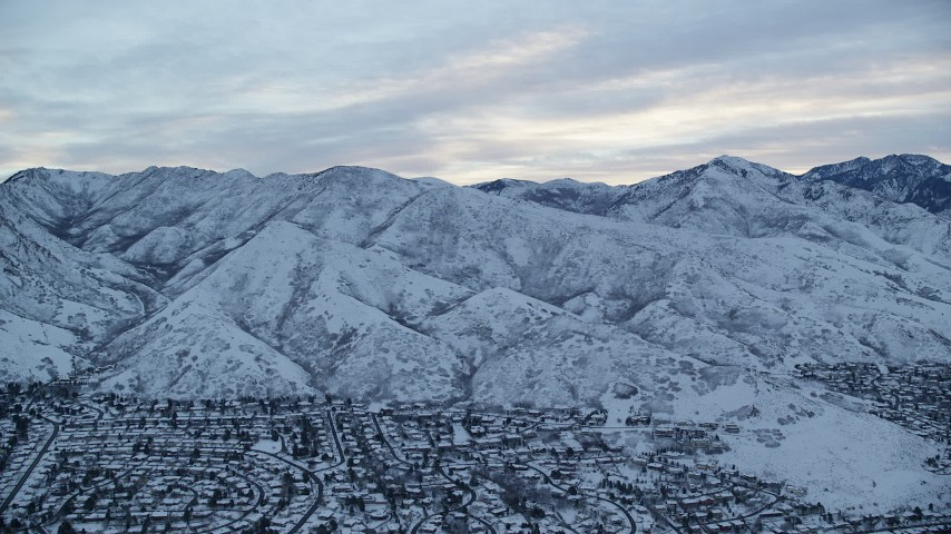 6K stock footage aerial video approach Wasatch Range in Utah at Sunrise in Winter Aerial Stock Footage | AX124_019