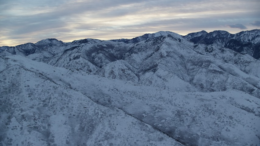 6K stock footage aerial video approach Wasatch Mountains at Sunrise in Winter in Utah Aerial Stock Footage   AX124_022