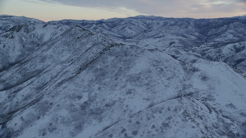 6K stock footage aerial video orbit snowy mountain ridge at Sunrise in Wasatch Range, Utah Aerial Stock Footage | AX124_024