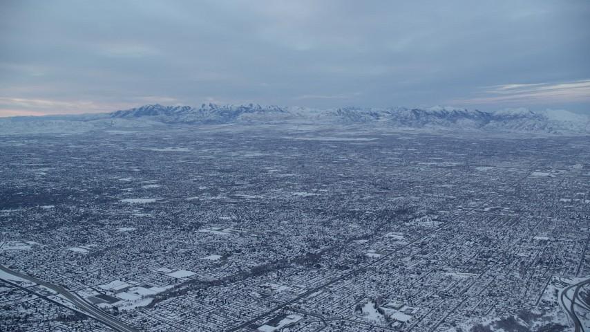 6K stock footage aerial video of suburban neighborhoods in Salt Lake City, Utah, at Sunrise in Winter Aerial Stock Footage   AX124_029