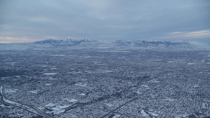 6K aerial video of Salt Lake City suburbs at Winter Sunrise in Utah Aerial Stock Footage AX124_030