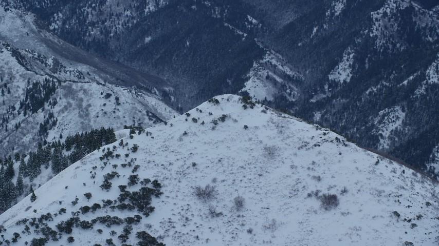 6K stock footage aerial video orbit snowy top of Grandeur Peak in Winter at Sunrise in Utah Aerial Stock Footage | AX124_031