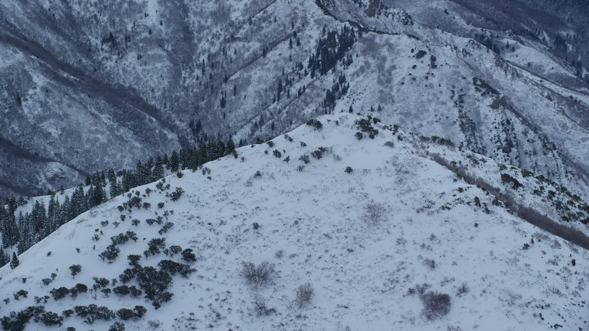 6K stock footage aerial video orbit summit of Grandeur Peak at Sunrise in Utah Aerial Stock Footage | AX124_032