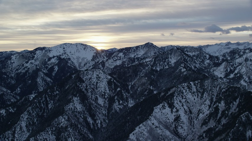 Snowy Wasatch Range Mountains at Sunrise in Utah Aerial Stock Footage   AX124_034