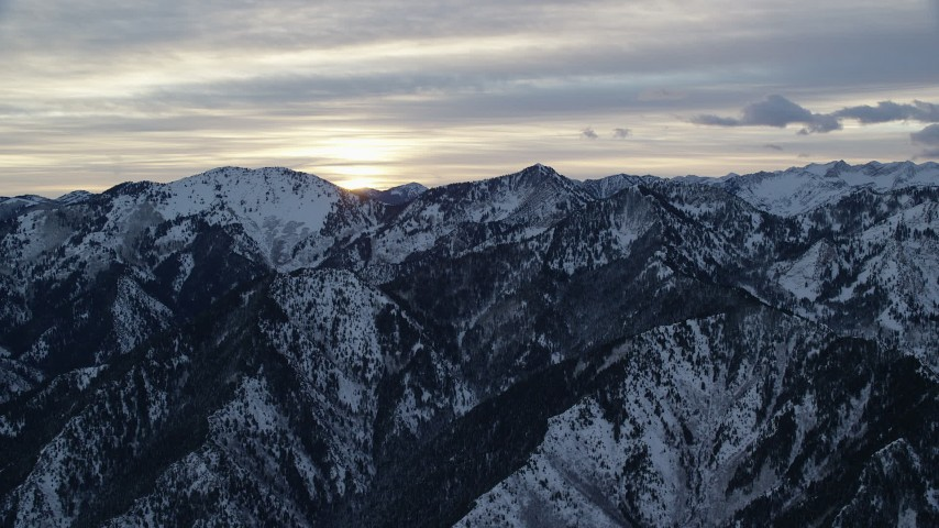 6K stock footage aerial video of snowy Wasatch Range mountains at Sunrise in Utah Aerial Stock Footage | AX124_034