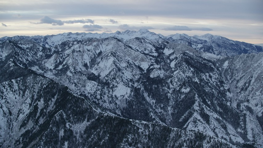 6K stock footage aerial video approach snowy mountains in the Wasatch Range at Sunrise in Utah Aerial Stock Footage   AX124_035
