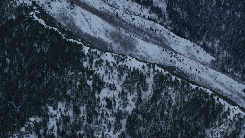 6K stock footage aerial video orbit mountain ridge with winter snow at Sunrise, Wasatch Range, Utah Aerial Stock Footage | AX124_037