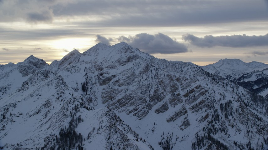 Winter Snow on Wasatch Range Peaks at Sunrise Aerial Stock Footage | AX124_059