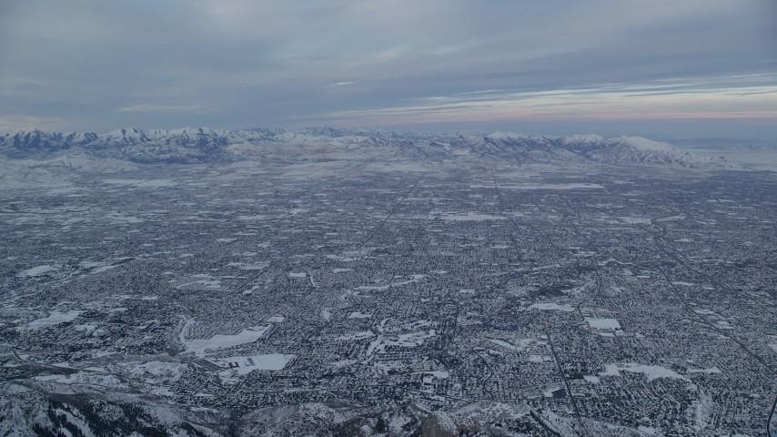 6K stock footage aerial video of vast Salt Lake City suburban neighborhoods at sunrise in winter, Utah Aerial Stock Footage | AX124_061