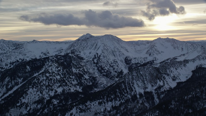 6K stock footage aerial video approach peaks with winter snow in Wasatch Range at sunrise in Utah Aerial Stock Footage | AX124_066
