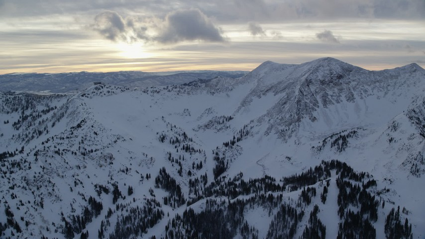 6K stock footage aerial video of mountains with winter snow at sunrise in Wasatch Range, Utah Aerial Stock Footage   AX124_071