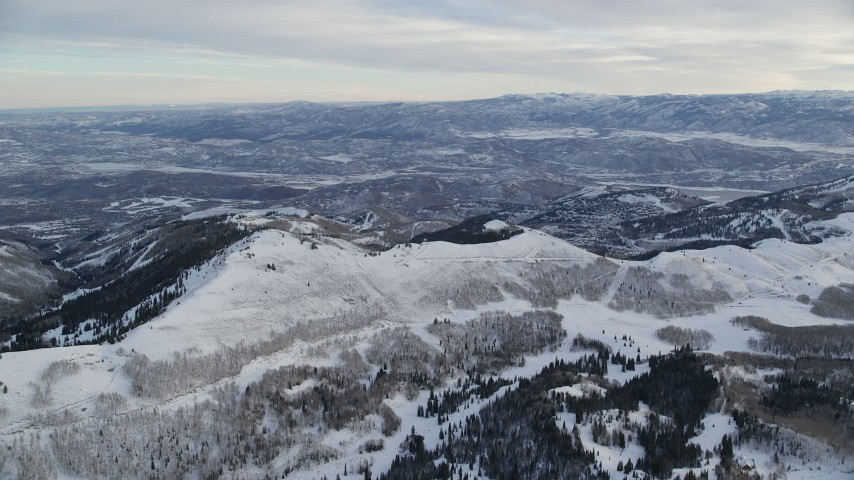 Approach Snowy Ridge at Sunrise in Wasatch Range, Utah Aerial Stock Footage | AX124_086