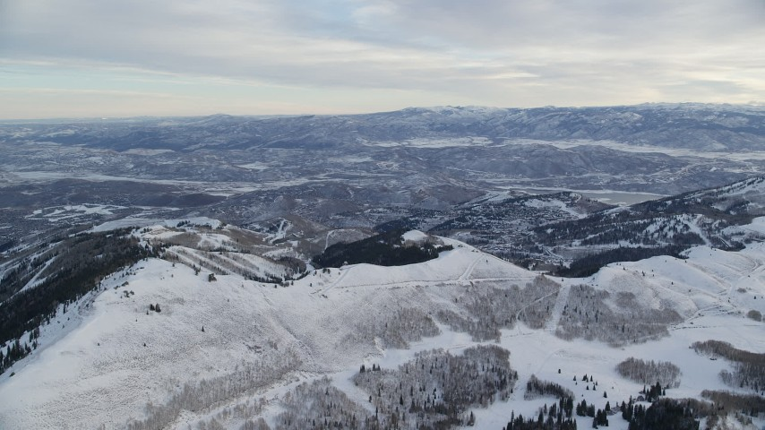 Approach Snowy Wasatch Range Ridge at Sunrise in Utah Aerial Stock Footage   AX124_087