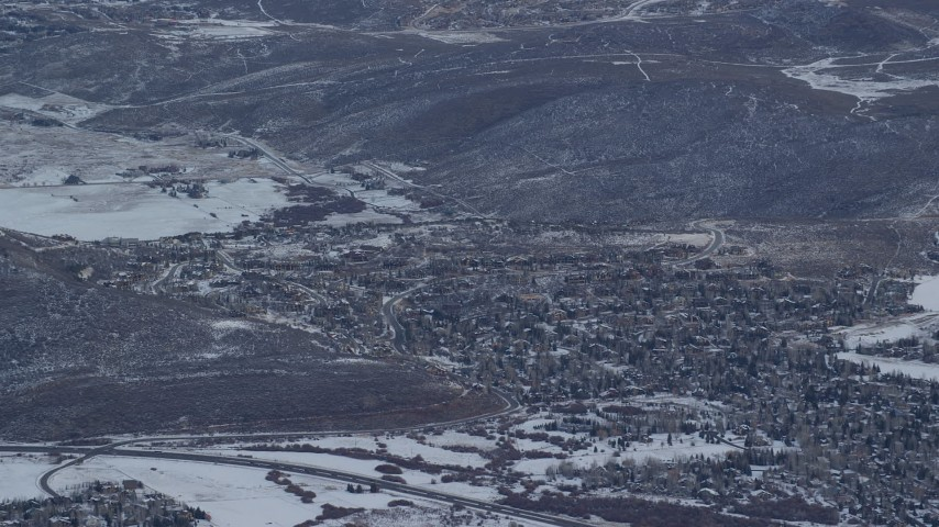 6K stock footage aerial video of rural neighborhood with winter snow in Park City at sunrise, Utah Aerial Stock Footage   AX124_091
