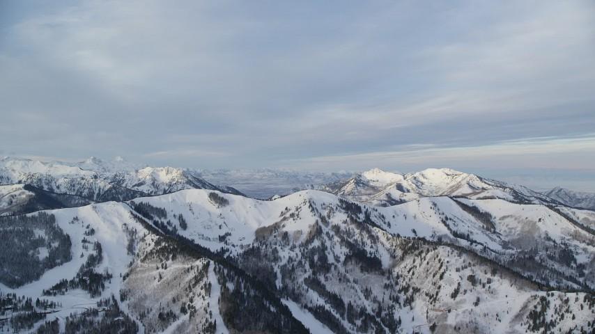 6K stock footage aerial video of snowy mountain ridge in winter at sunrise in Utah Aerial Stock Footage | AX124_095