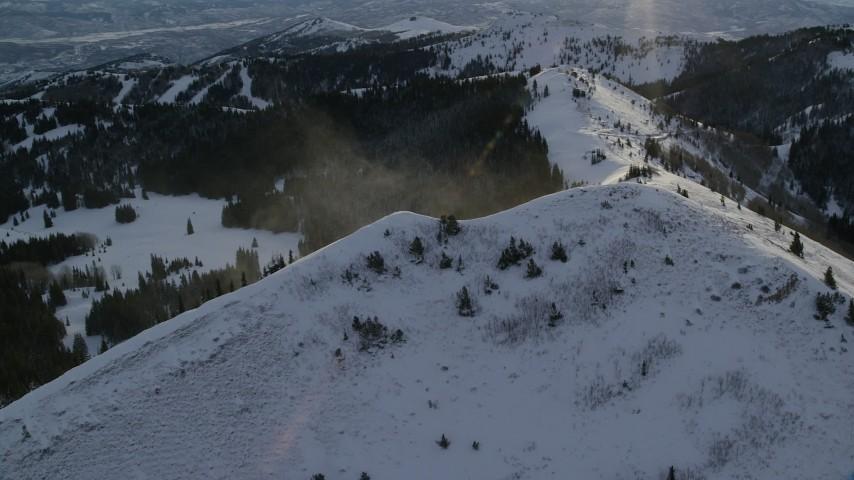 6K stock footage aerial video orbit a snowdrift on the summit of a snowy peak at sunrise in Utah's Wasatch Range Aerial Stock Footage   AX124_112