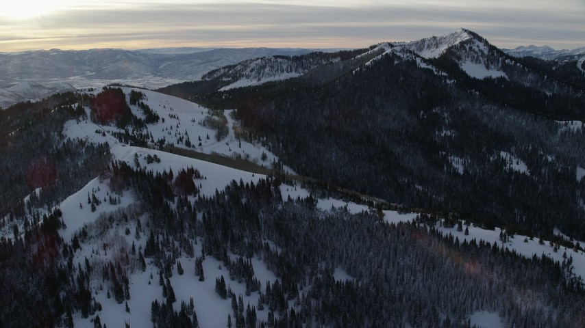 6K stock footage aerial video approach snow-covered mountains at sunrise in Utah's Wasatch Range Aerial Stock Footage AX124_114 | Axiom Images