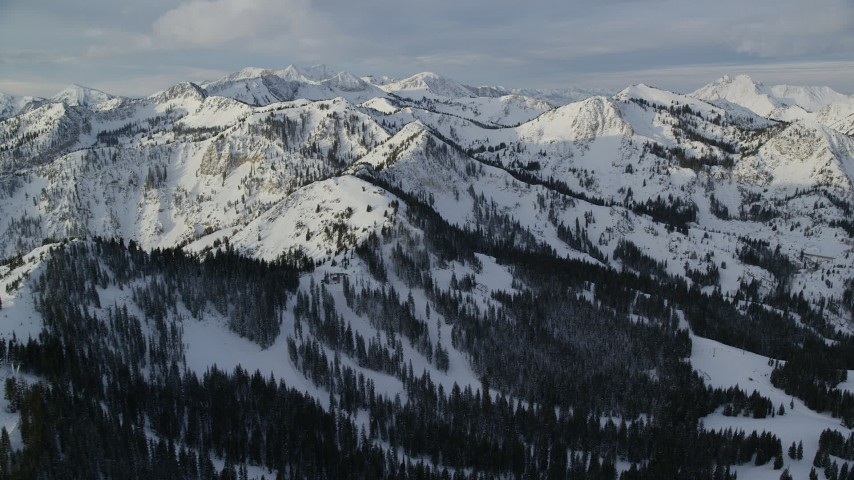 6K stock footage aerial video of Wasatch Range snow mountains at sunrise in wintertime in Utah Aerial Stock Footage   AX124_125