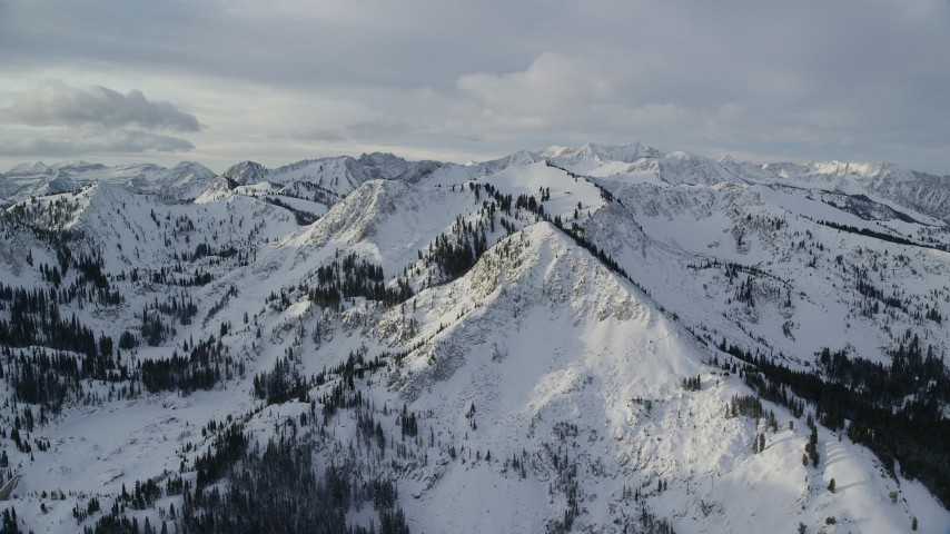 Orbit of Snowy Wasatch Range Mountain Peaks in Utah Aerial Stock Footage | AX124_130