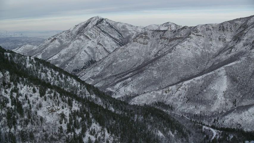 6K stock footage aerial video approach Grandeur Peak in the wintery Wasatch Range at sunrise, Utah Aerial Stock Footage | AX124_164