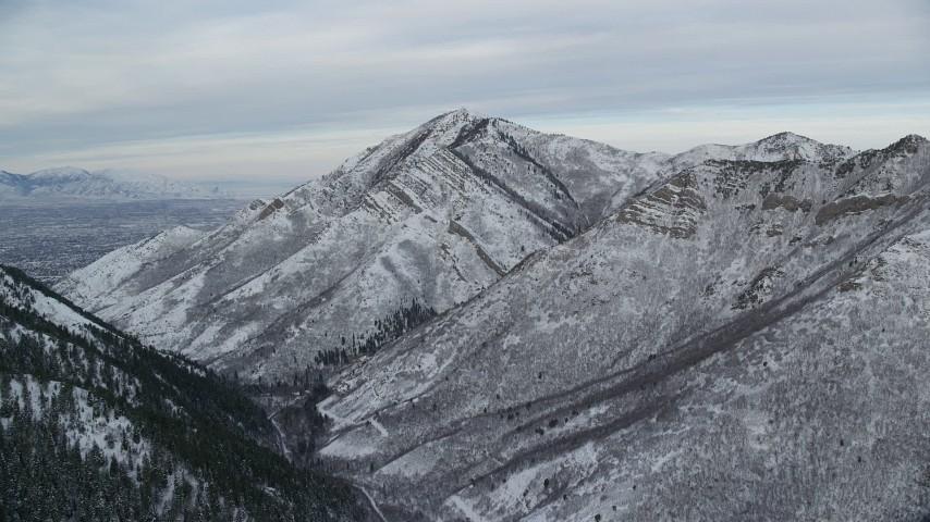 6K stock footage aerial video approach snowy Grandeur Peak in winter at sunrise, Utah Aerial Stock Footage | AX124_165