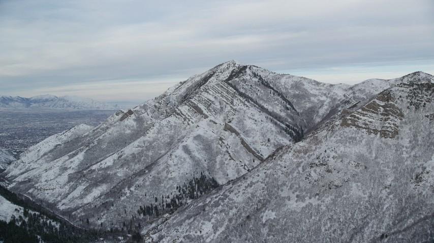 6K stock footage aerial video approach Grandeur Peak with winter snow at sunrise in Utah Aerial Stock Footage | AX124_166
