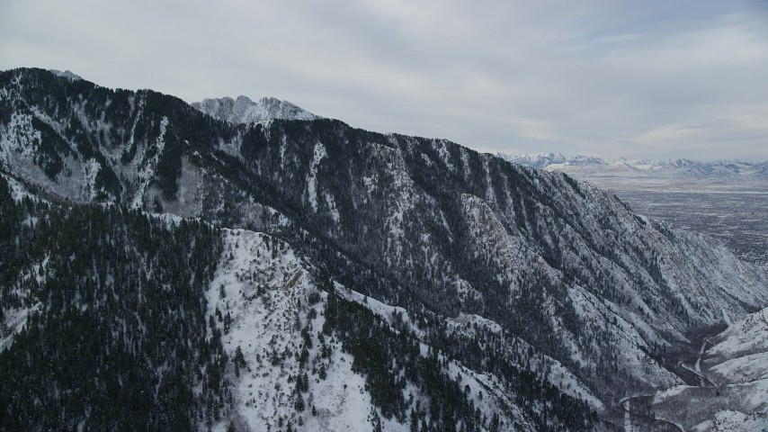 6K aerial video flyby mountain ridge with snow at sunrise in Wasatch Range, Utah Aerial Stock Footage | AX124_168